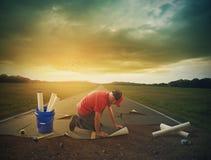 Mężczyzna buduje drogę Fotografia Stock