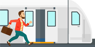 Mężczyzna chybiania pociąg Obrazy Royalty Free