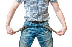 Mężczyzna - dłużnik pokazuje puste kieszenie jego cajgu ans symbol żadny pieniądze Zdjęcia Royalty Free