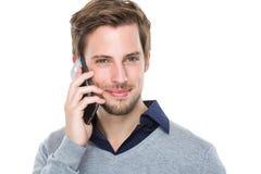 Mężczyzna gadka z telefonem komórkowym Fotografia Royalty Free