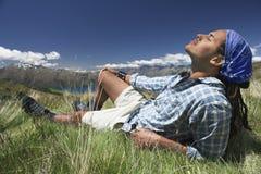 Mężczyzna lying on the beach W polu Obraz Royalty Free