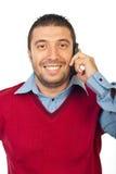 Mężczyzna ma rozmowę telefonu wiszącą ozdobą Obraz Royalty Free