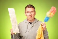 Mężczyzna nieszczęśliwy czyścić dom Fotografia Royalty Free