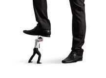 Mężczyzna pod dużą nogą jego szef Fotografia Royalty Free