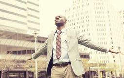 Mężczyzna świętuje wolność sukcesu ręki podnosił przyglądający up Obrazy Stock