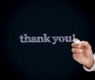 Mężczyzna writing dziękuje ciebie z kredą Zdjęcia Royalty Free