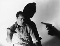 Mężczyzna z nożem przy gunpoint (Wszystkie persons przedstawiający no są długiego utrzymania i żadny nieruchomość istnieje Dostaw Obraz Stock