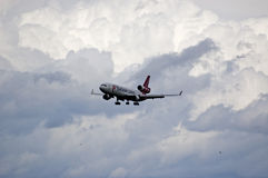 MD-11 landing in the clouds Stock Images