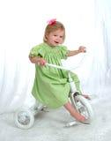 Mädchen auf Dreirad Stockfotografie