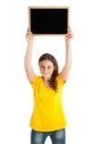 Mädchen, das Brett hält Stockbilder