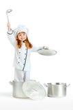 Mädchen, das Chef kochend spielt Stockfoto