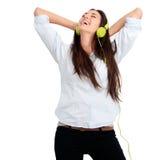 Mädchen, das mit Musik glücklich sich fühlt Lizenzfreie Stockbilder