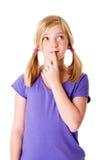 Mädchen, das an Optionen denkt Lizenzfreie Stockbilder
