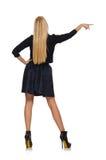 Mädchen des blonden Haares im dunkelblauen Rock an lokalisiert Stockbild