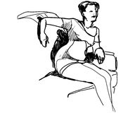 Mädchen im kurzen Kleid auf der Couch Stockfoto