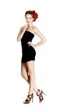 Mädchen im kurzen schwarzen Kleid Stockfotografie