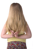 Mädchen mit den Fingern kreuzte nach zurück Stockfotos