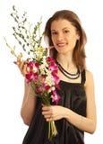 Mädchen mit einem Blumenstrauß. Getrennt auf Weiß Lizenzfreie Stockfotografie