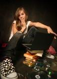 Mädchen mit einem Computer Stockfoto