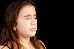 Mädchen mit einem sehr traurigen Gesichtsschreien Stockfotografie