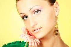 Mädchen mit einer Blume Lizenzfreie Stockbilder