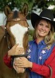 Mädchen und Pferd Stockbild