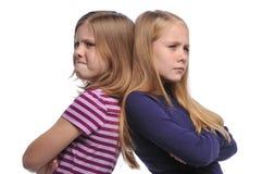 Mädchen zwei, das eine $überschneidung löst Lizenzfreie Stockbilder