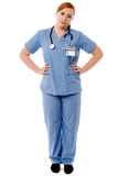 Médico de sexo femenino que presenta ocasional Imagenes de archivo