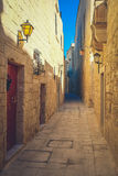 Mdina city streets - Malta. Famous narrow streets in the old cit. Adel at sunset Stock Photos