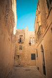 Mdina city streets - Malta. Famous narrow streets in the old cit. Adel at sunset Royalty Free Stock Photography