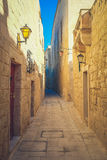 Mdina city streets - Malta. Famous narrow streets in the old cit. Adel at sunset Royalty Free Stock Photos
