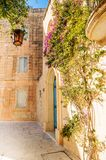 Mdina courtyard with fuchsiaflowers, malta Stock Image