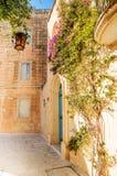 Mdina courtyard with fuchsiaflowers, malta Stock Image