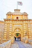 Mdina Gate and entrance into old fortified city Malta. Mdina, Malta - April 4, 2014: Mdina Gate and entrance into the old fortified city, Malta. People on the Royalty Free Stock Photo