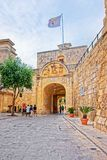 People at Entrance gate into Mdina old city Stock Photo