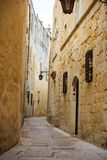 Malta, Mdina. Old medieval city narrow streets, houses sandstone facades. Mdina, Malta island. Old medieval city narrow streets, houses sandstone facades and Royalty Free Stock Image