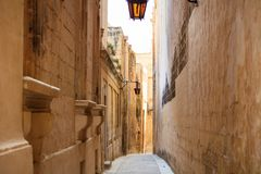 Malta, Mdina. Old medieval city narrow streets, houses sandstone facades. Mdina, Malta island. Old medieval city narrow streets, houses sandstone facades and Stock Images