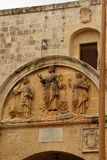 Mdina, Malta, July 2014. Fragment of the old stone wall with the image of the three saints stock photography
