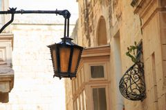 Picturesque facade with lanterns inside the ancient fortified city of Mdina, Malta. Maltese architecture. Mdina, Malta Maltese old architecture Stock Image