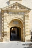 Entrance gate to Mdina, a fortified medieval city in Malta. Mdina, Malta - 1 November 2017: Entrance gate to Mdina, a fortified medieval city in the Northern Stock Photo