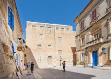 Mdina. MALTA - SEPTEMBER 15, 2015: Local police station inside The Silent City on a sunny day with some tourists in September 14, 2015 in , Malta Royalty Free Stock Images