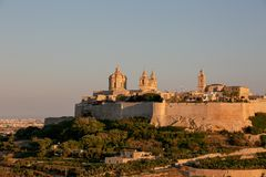 Mdina at Sunset. The Mdina skyline kissed by the last of the sun`s rays at sunset stock image