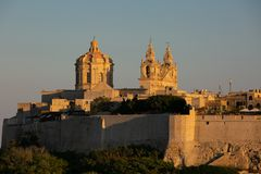 Mdina at Sunset. The Mdina skyline kissed by the last of the sun`s rays at sunset stock photo
