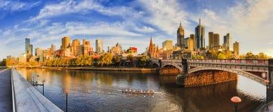 ME CBD Morning Yarra Pan. Warm golden light over Melbourne city CBD across Yarra river from Southbank between Walk foot bridge and Princes bridge in earlier Royalty Free Stock Photo