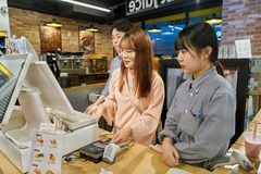 With Me convenience store. SEOUL, SOUTH KOREA - CIRCA MAY, 2017: workers at a convenience store in Seoul royalty free stock images