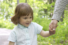 Me and dad. Little, cute girl walking hand in hand with father Stock Image