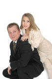 Me and Dad. Young girl leaning on her fathers shoulder as he kneels down on the floor. This is an image from a father taking his daughter to the annual father royalty free stock photos