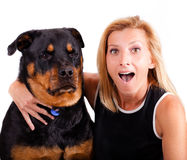 Me, excited! Dog. not so much. Self portrait of a blond woman with an excited expression and her dog who is not so excited stock images