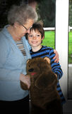 Me and grandma. Grandmother and grandson are playing together with a plush bear Stock Image