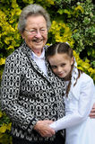 Me and grandma. Girl on day of the first holy communion  is hugging his grandmother Royalty Free Stock Photography